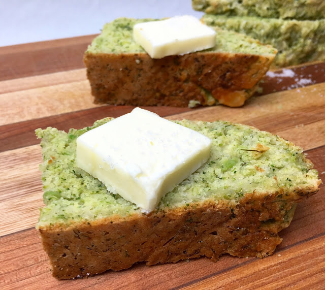 Slices of Cheddar Broccoli Quick Bread with Butter and Salt