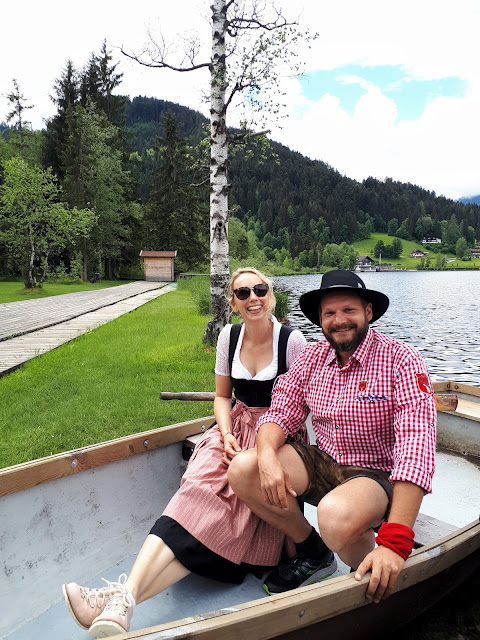 Bjorn Troch, The Social Traveler and Lea from Escape Town in a boat at Schwarzsee in Kitzbühel