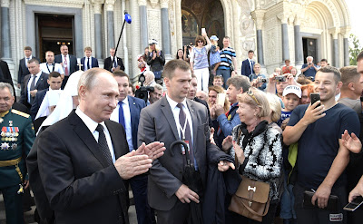 Vladimir Putin with Kronstadt residents after visiting the Naval Cathedral of St. Nicholas.