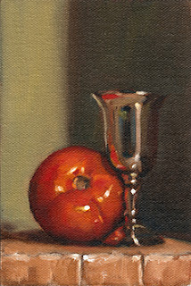 Oil painting of a red tomato beside a small silver-plated goblet.
