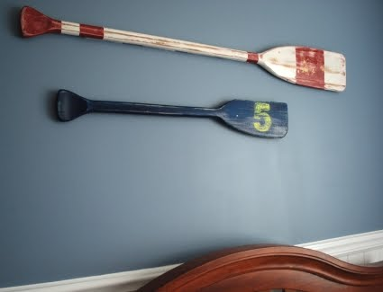 painted oars on wall