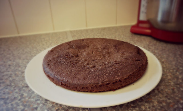 A layer of chocolate sponge cake, sunk in the middle.