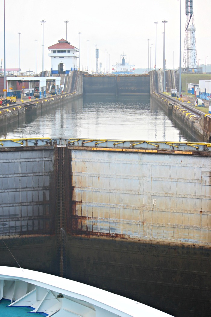 view from the rear of the ship going through the panama canal lock system
