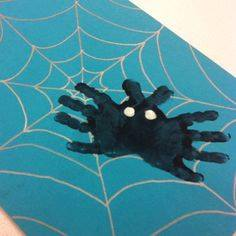 Idea to draw spider using handprint for kids
