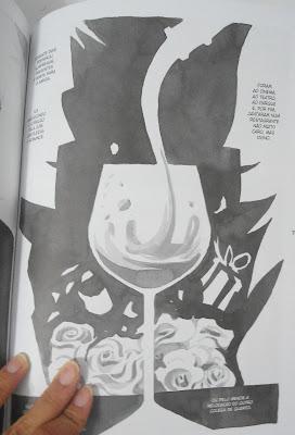 Foto da página 79, a silhueta de um casal e uma taça de vinho no meio da página
