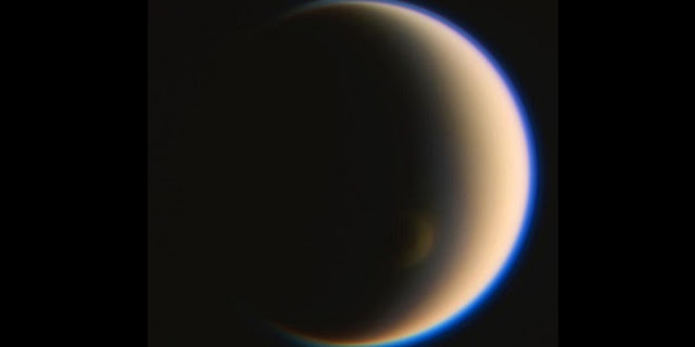 Titan's winter polar vortex imaged by the Cassini Spacecraft's ISS camera. The vortex is now in deep winter and can only be seen because the polar clouds within the vortex extend high above Titan's surface into the sunlight. The vortex was extremely cold from 2012-2015 giving rise to unusual nitrile ice clouds. NASA/JPL-Caltech/Space Science Institute/Jason Major