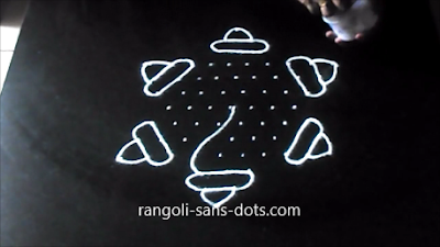 shankh-rangoli-with-dots-1211ac.jpg