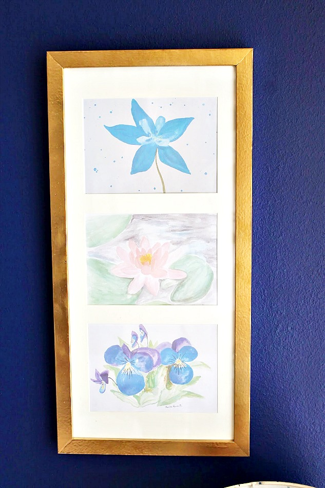 Gold frame with flowers on blue wall