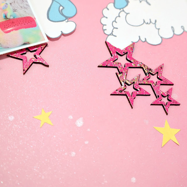 Pink Embossed Chipboard Star Clusters and Yellow Paper Stars on Misted Pink Background