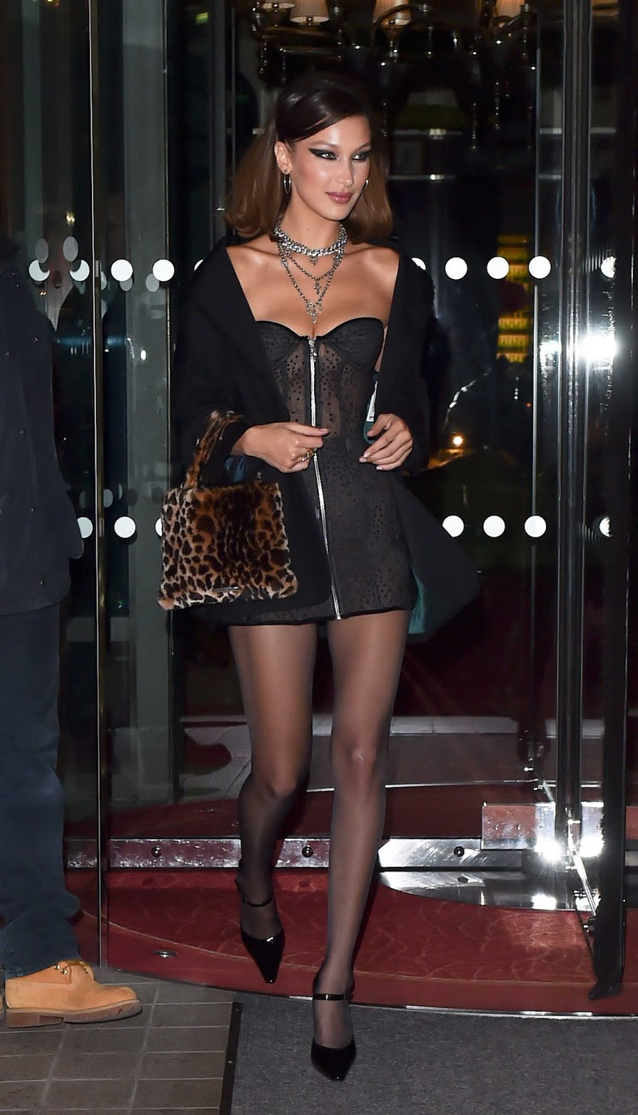 Bella Hadid Beautiful Cleavages as she bends down happily to expose her massive tits
