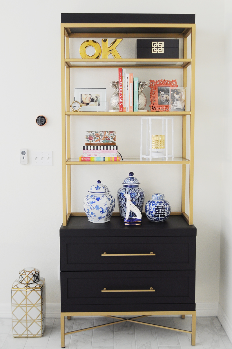 Tips and ideas for how to perfectly style a chic, curated bookshelf or bookcase using books, photos, art, candles, ginger jars and other decor.