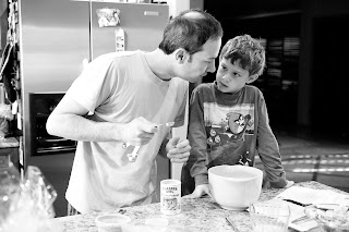 father son making pancakes