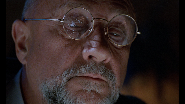 donald pleasance with some goo on his glasses