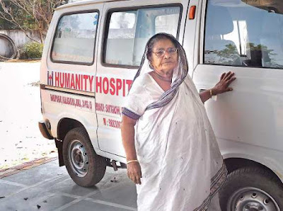 Subhashini mistry in front of an Ambulance Humanity Hospital