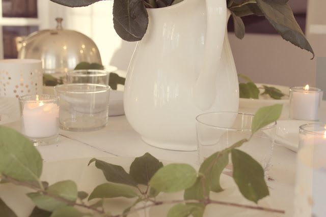 White farmhouse table with ironstone, candlelight, and greenery by Hello Lovely Studio