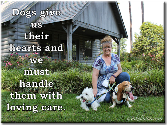 Woman, Basset hound and Westie in fron of wooden house with dog quote