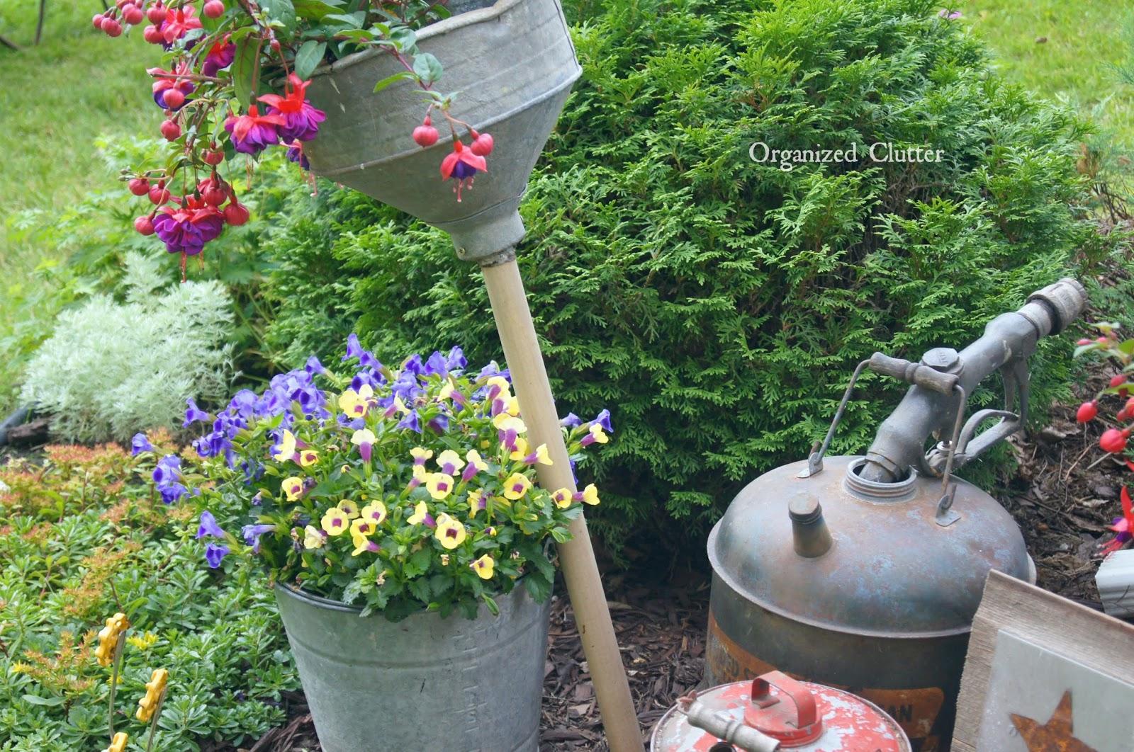 Oil Cans, Funnels & Gas Nozzle www.organizedclutterqueen.blogspot.com