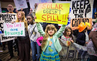 Children take part in a protest in the New Orleans Superdome against a new auction of federal Gulf of Mexico drilling leases. (Image Credit: Julie Dermansky ©2016) Click to Enlarge.
