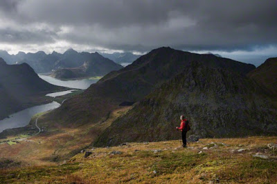 Hiker on trail towards summit of Stornappstind