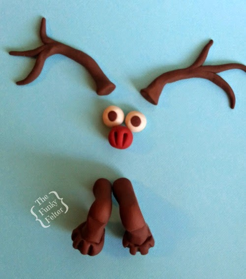 handmade polymer clay reindeer parts for a crocheted reindeer by the funky felter