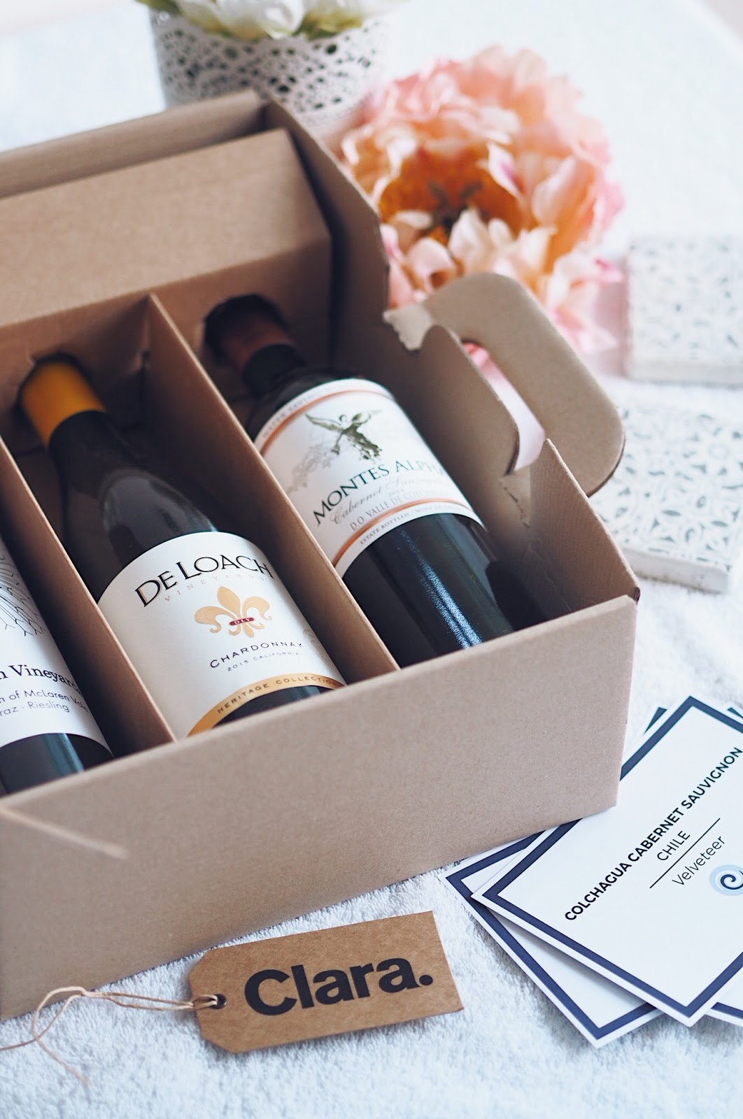 Brown cardboard box containing bottles of wine