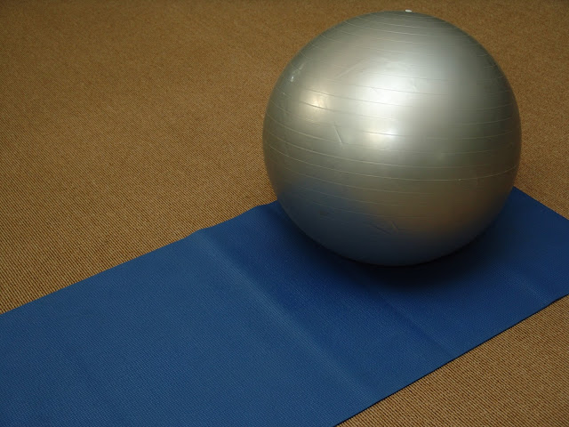 blue yoga mat silver exercise ball