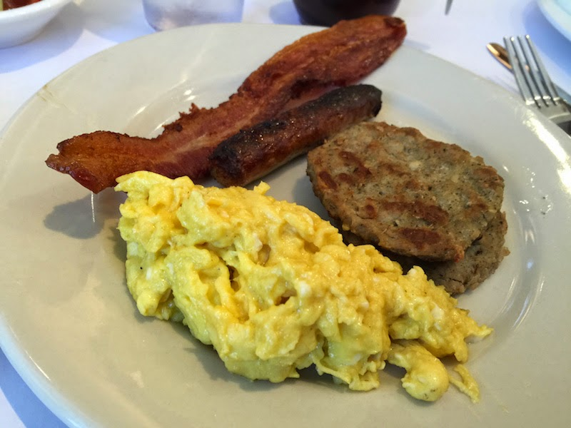 Scrambled eggs, sausage, and bacon at the Sunday breakfast brunch at Souls Restaurant in Oakland, CA