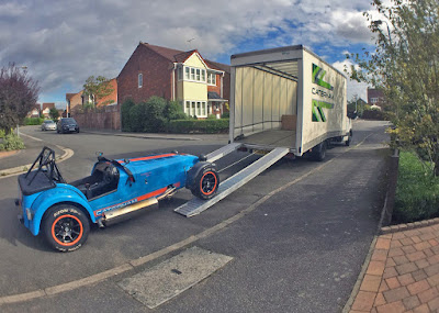 The R500 being unloaded off the Caterham Van