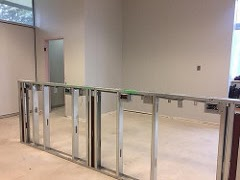Steel skeleton of the knee wall being installed to provide electrical outlets