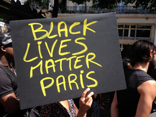protest in france for the death of a black man in a police custoday, protesters say black lives matter