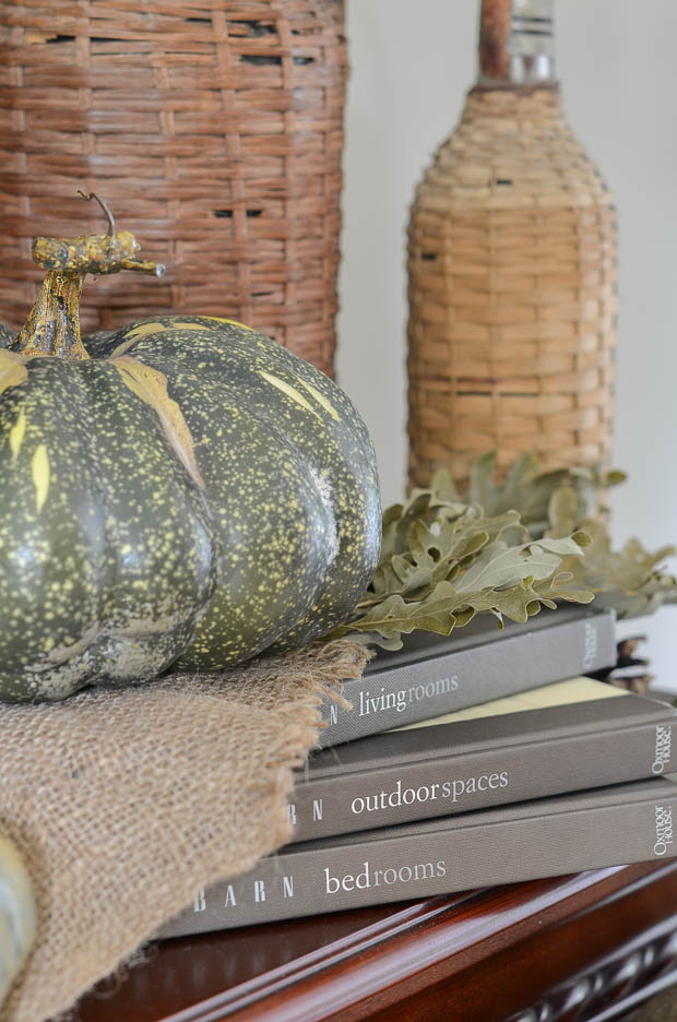 Use books to add different levels to your fall mantel display.