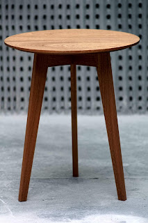 A small mahogany coffee table with a circular top