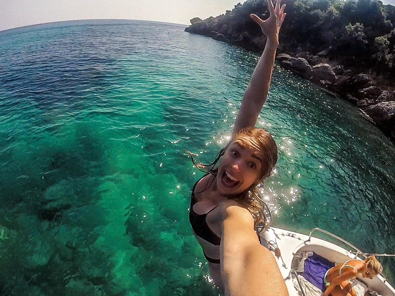 Girl jumping in sea