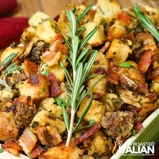 closeup of crockpot stuffing topped with sprig of fresh thyme