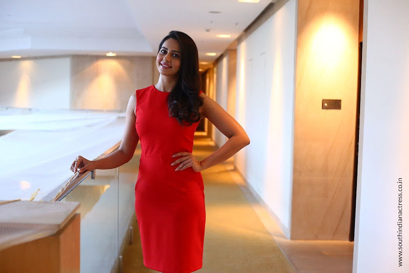 Rakul Preet Singh in red dress at Theeran Adhigaram Ondru Interview
