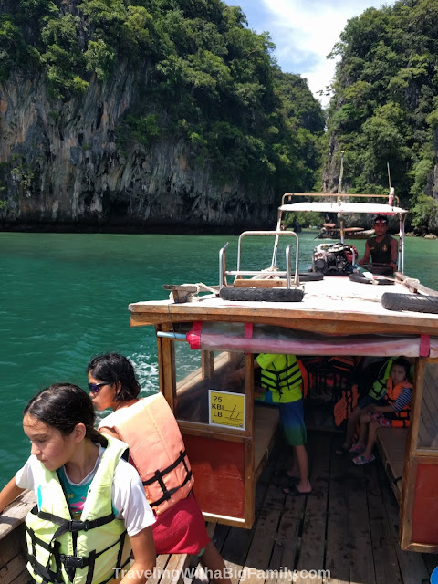 Going on a long-tail boat ride to see the islands with a big family