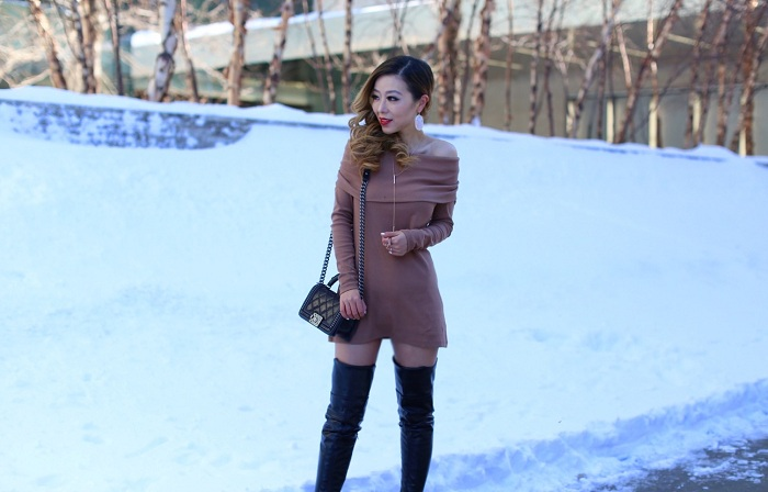 pixie market Brown off the shoulder knit dress, chanel boy bag, kendra scott shelton necklace, kendra scott earrings, wanderlust and co ring, leather over the knee boots, winter date night outfit, off shoulder knit dress