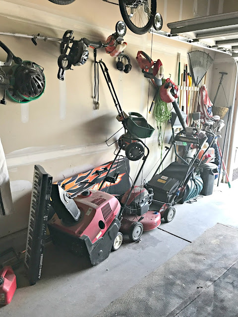 Organizing lawn equipment in garage