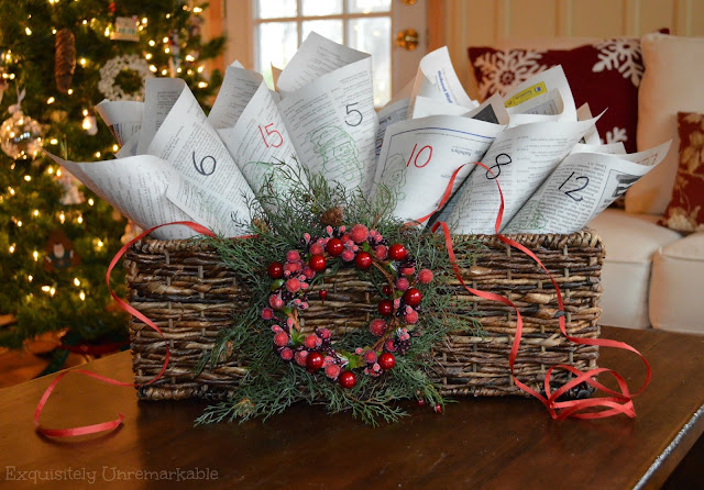 Stamped Newspaper Advent Calendar in a holiday basket in front of the tree