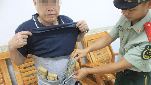 'Chunky' Chinese man caught trying to cross border to Hong Kong with $74,000 strapped to his waist