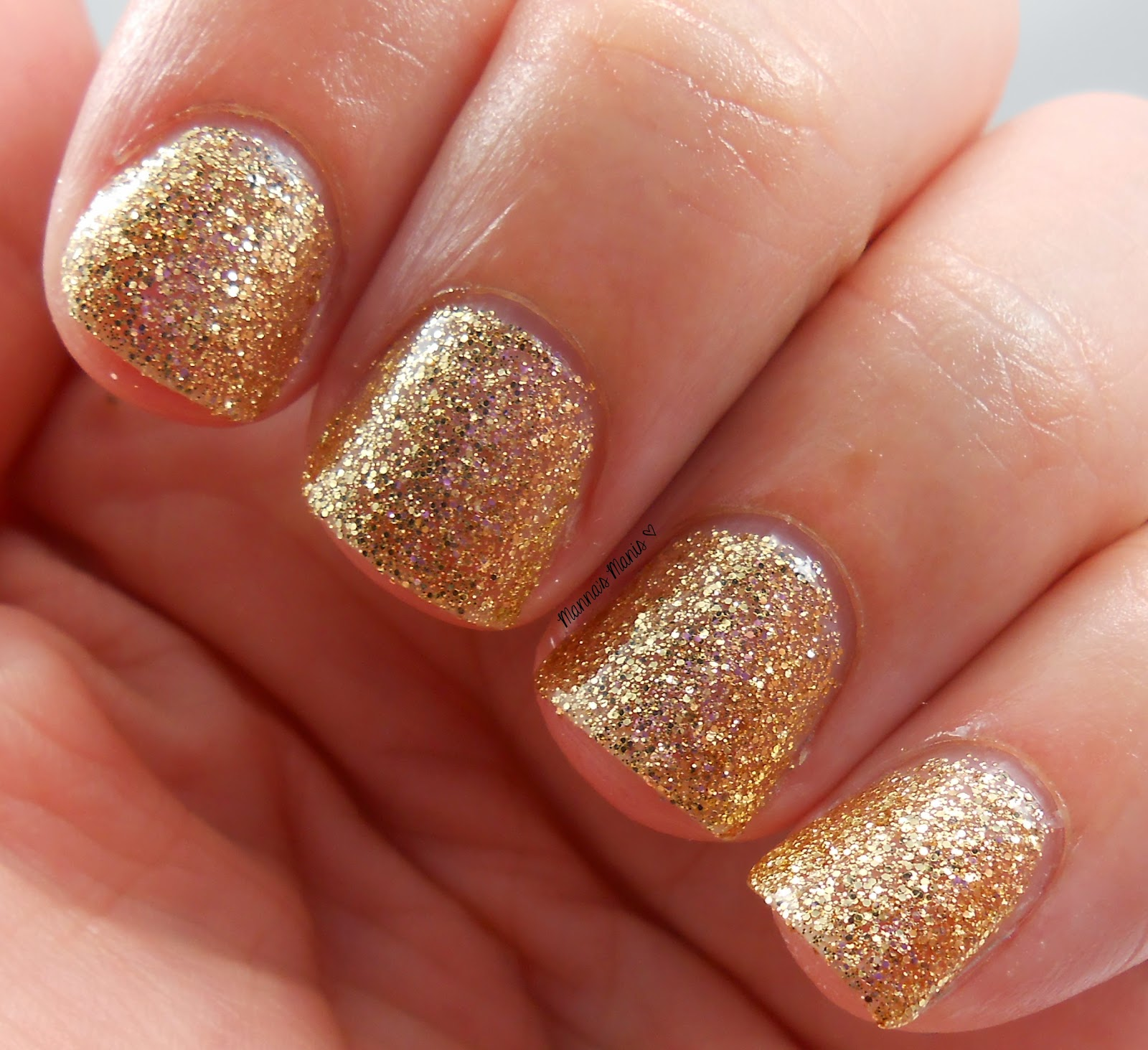 fingerpaints wrapped in ribbon, a full coverage gold microglitter nail polish
