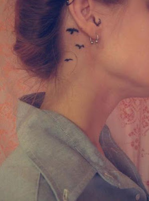 tatuaje oreja gaviotas