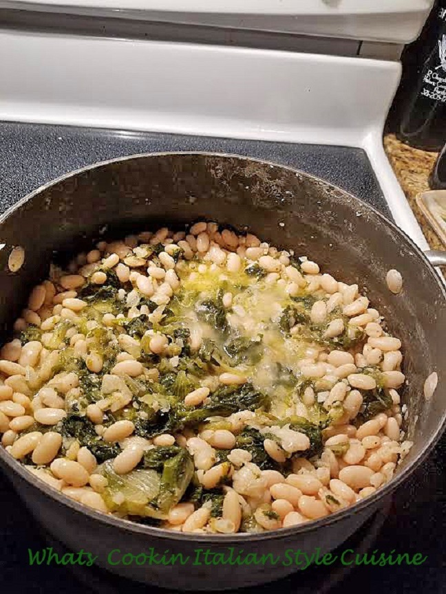 This is a pan full of white beans and escarole that was considered depression food back in 1940s and now this Italian food is a delicious pot of rich flavors or garlic, herbs, spices and the greens and beans is the perfect comfort food.