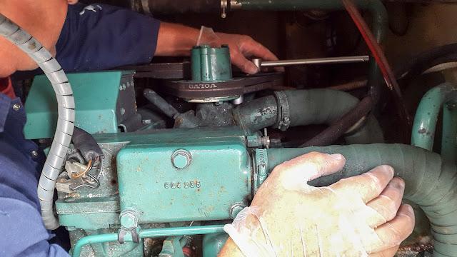 Photo of Phil adjusting Ravensdale's drive belts
