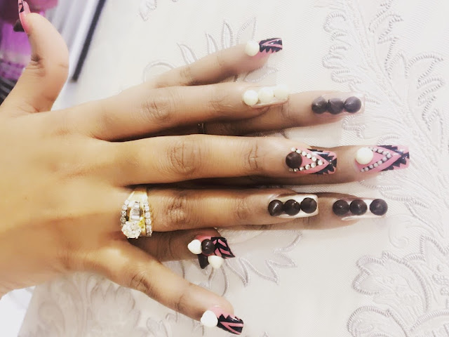 Cleopatra : Enhance your appetite for love with chocolate nail makeovers.