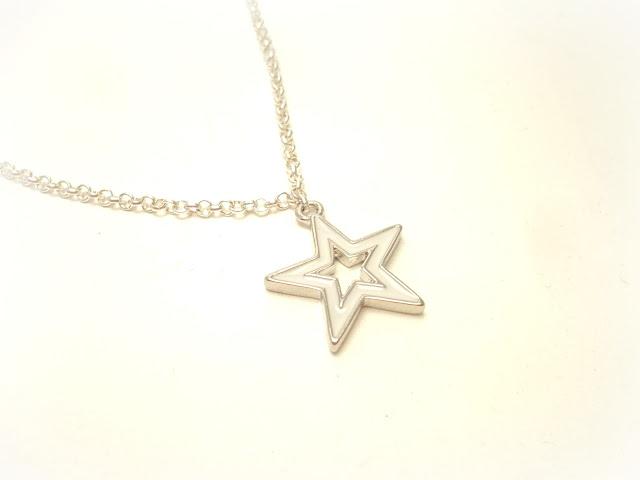 estrella plata y blanco