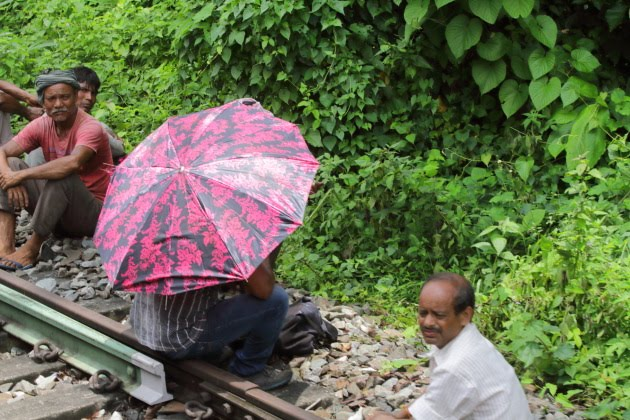 Railway Track Maintenance Staff taking a break, Assam, India