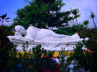 White Sleeping Buddha In The Garden Of Brahmavihara Arama Monastery North Bali