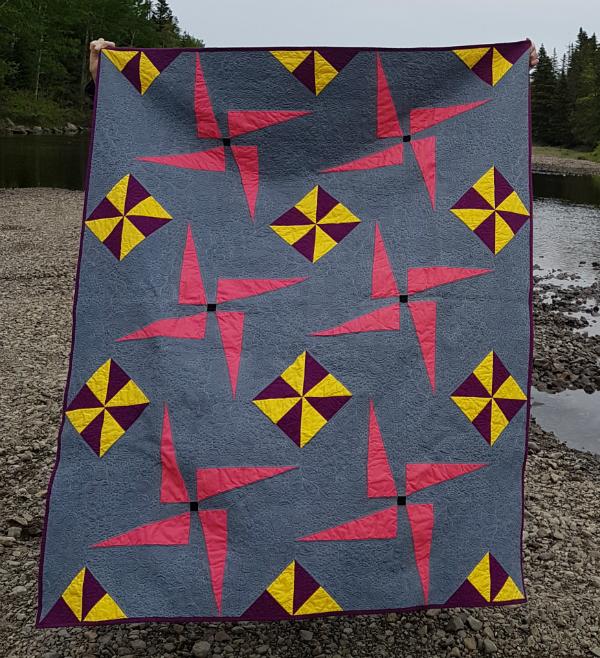 Pinwheel Whirl quilt | DevotedQuilter.blogspot.com