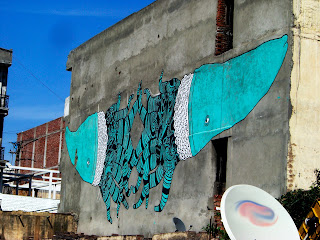 Street art of two giant squids on a building